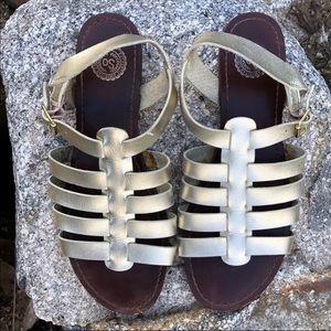 Gold flat gladiator sandals